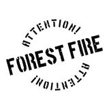 Forest Fire rubber stamp. Grunge design with dust scratches. Effects can be easily removed for a clean, crisp look. Color is easily changed Royalty Free Stock Photo