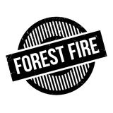 Forest Fire rubber stamp. Grunge design with dust scratches. Effects can be easily removed for a clean, crisp look. Color is easily changed Stock Photography