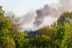 Forest fire view from afar. Smoke of a forest fire from afar in the countryside Stock Image