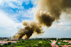 Forest fires in the city on a hot oversupply. Firefighter helped hasten to prevent fire spread to the village. Royalty Free Stock Photo