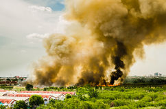 Forest Fires In The City On A Hot Oversupply. Firefighter Helped Hasten To Prevent Fire Spread To The Village. Stock Image