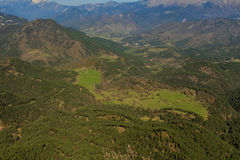 The forest gives way to a clearing, from Pedró de Tubau.  stock photography