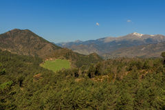 The forest gives way to a clearing, with the Pedraforca in the background.  royalty free stock image