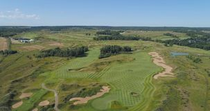 Forest and golf course. Aerial view Golf course with green grass and ponds. Golf field in the countryside stock video