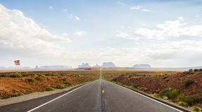 Forest Gump Point with Navajo American flag - Monument Valley scenic panorama on the road - Arizona, AZ Stock Photography