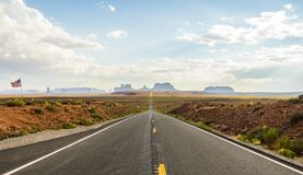 Forest Gump Point with Navajo American flag - Monument Valley scenic panorama on the road - Arizona, AZ Royalty Free Stock Photo