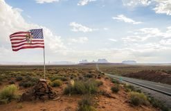 Forest Gump Point with Navajo American flag - Monument Valley scenic panorama on the road - Arizona, AZ Stock Photo