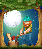 A forest with a hardworking woodman chopping woods Stock Photos