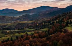 Forest on hills in mountainous countryside at dawn Royalty Free Stock Photography
