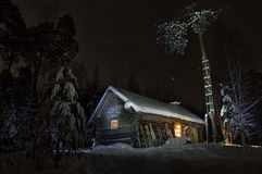 Forest House. In the winter under the starry sky Royalty Free Stock Image