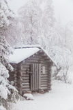 Forest hut covered with frost. Finnish Lapland Royalty Free Stock Images