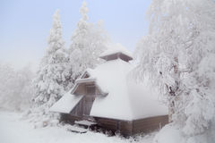 Forest hut covered with snow. Stock Photo