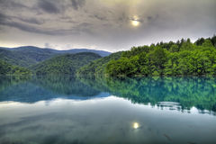 Forest lake. HDR image of forest lake with reflections royalty free stock photos