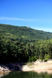 Forest lake. View of a forest lake with a rock on top of the hill with blue sky in Sintra, Portugal Stock Image