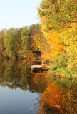 Forest lake in the autumn. Fishing on the lake in the woods Stock Image