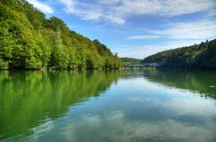 Forest lake with blue cloudy sky, Romania Royalty Free Stock Photo