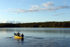 Forest lake. Boat Stock Images