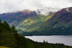 Forest and Lake Derwent Water in Keswick, Lake District, UK. Dramatic view of the forest and Lake Derwent Water in Keswick, Lake District, Cumbria, UK Royalty Free Stock Images