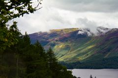 Forest and Lake Derwent Water in Keswick, Lake District, UK- tel. Dramatic view of the forest and Lake Derwent Water in Keswick, Lake District, Cumbria, UK Stock Photos