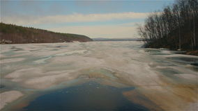 Forest lake. Ice-covered lake in spring forest stock footage