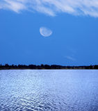 Forest lake and moon Stock Photo