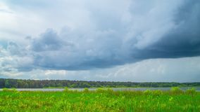 Forest lake and rain clouds, panoramic time-lapse stock video footage
