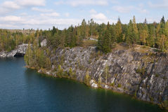 Forest lake in the rocks. View of the forest lake in the rocks of marble Stock Images