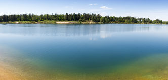 Forest Lake with Sand beach bed bottom Royalty Free Stock Photos