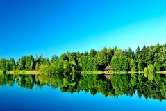 Forest Lake with a sauna on the shore royalty free stock images