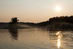 Forest lake in the setting sun. Stock Images