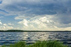 Forest lake before stormy rain Royalty Free Stock Photography