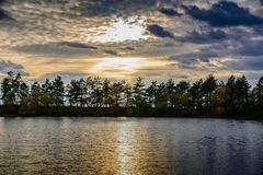 A forest lake at sunset Royalty Free Stock Photos