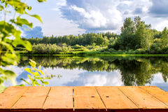Forest lake and wooden board background Stock Image