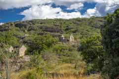 Forest landscape with a hill and two stone houses. Igatu, Bahia, Brazil royalty free stock photography