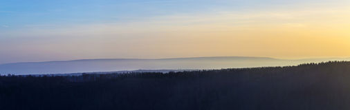 Forest landscape at Kyffhaeuser in sunset Stock Photos