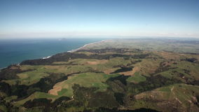 Forest in landscape of ocean view from above in New Zealand. Travel and tourism in the world of wildlife stock footage