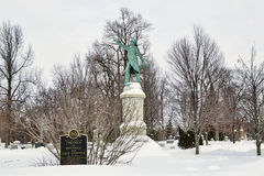 Forest Lawn Cemetery. Firefighter memorial in Buffalo's Forest Lawn Cemetery. This statue is at the center of two rings of firefighter graves royalty free stock image