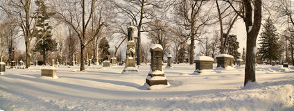 Forest Lawn Cemetery. Gravestones shrouded in snow in Buffalo, New York's Forest Lawn Cemetery Royalty Free Stock Images