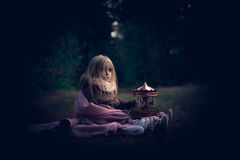 In forest with light 2. 2-3 years old little girl in forest with candle and christmas staff Royalty Free Stock Photography