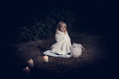 In forest with light 2. 2-3 years old little girl in forest with candle and christmas staff Royalty Free Stock Photos