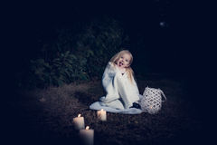In forest with light 2. 2-3 years old little girl in forest with candle and christmas staff Royalty Free Stock Photo