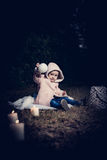 In forest with light. 2-3 years old little girl in forest with candle and christmas staff Royalty Free Stock Photo