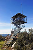 Forest lookout tower in Sierra Madrona, Ciudad Real province, Spain. Ranger in the fire prevention and surveillance tower located in Sierra Madrona, Ciudad Real Stock Photo