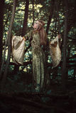 Forest maiden in dark woods Royalty Free Stock Image