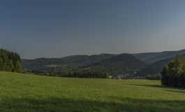 Forest and meadow over Kraslice town in summer very hot morning. Forest and meadow over Kraslice town in summer very hot sunny morning stock images