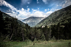 Forest, mountains and clouds. Landscape. Andorra. Toned Royalty Free Stock Image