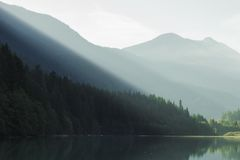 Forest and mountains by lake Royalty Free Stock Photography