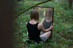Forest mystic mirror. On grass Royalty Free Stock Photography