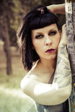 Forest nymph, brunette woman, tattoed Royalty Free Stock Images