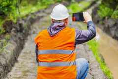 Forest officer filmed with tablet PC rutted forest road Stock Photos